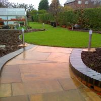 A luxurious patio by Country Lane Landscapes